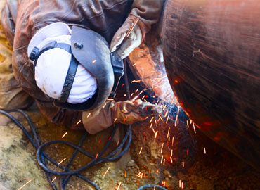 Employee works on pipe sections